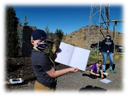 Image shows students taking notes about biocontrol sampling.